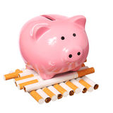 Piggy Bank and Cigarettes isolated Stock Images