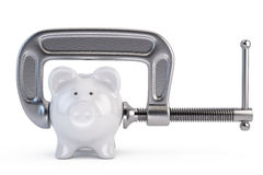 Piggy bank and clamp tool Royalty Free Stock Photos