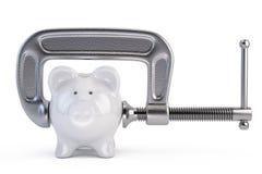 Piggy bank and clamp tool Royalty Free Stock Photos