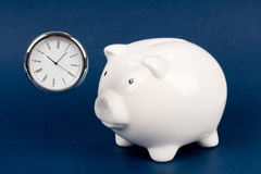 Piggy Bank and clock Royalty Free Stock Photography
