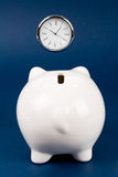 Piggy Bank and clock Royalty Free Stock Image