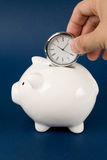 Piggy Bank and clock Stock Image