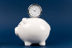 Piggy Bank and clock Stock Image