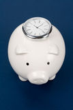 Piggy Bank and clock Royalty Free Stock Photo