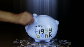 Piggy bank coin drop in black space,Piggy Bank Savings RMB and rays lights. stock video
