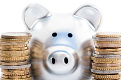 Piggy bank and coin stacks Stock Images