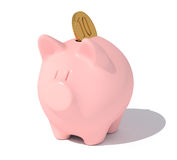 Piggy bank with a coin. Royalty Free Stock Photography