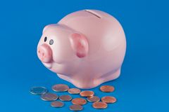 Piggy Bank and Coins Stock Image