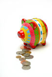 Piggy bank coins Royalty Free Stock Photography