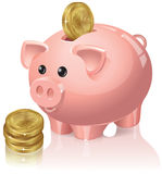 Piggy bank and coins Stock Photos