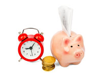 Piggy bank with coins and alarm clock Royalty Free Stock Images