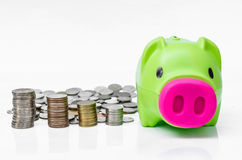 Piggy bank and coins background and arranged in stack Stock Photography