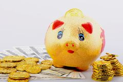 Piggy bank with coins and banknotes Stock Photo