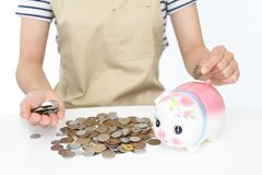 Piggy bank with coins Stock Photo