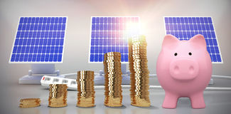 piggy bank and coins with Composite image of flare Royalty Free Stock Photo