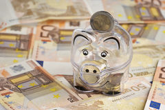 Piggy bank. Coins and euro bills. Banknotes closeup. Money saving concept Royalty Free Stock Images