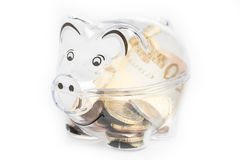 Piggy bank, coins and euro bills. Money saving concept. Banknotes closeup. Isolated background Royalty Free Stock Photos