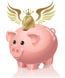 Piggy bank with coins flying Royalty Free Stock Photos