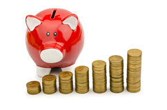 Piggy bank and coins isolated Royalty Free Stock Photography