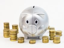 Piggy bank with coins isolated on a white background Royalty Free Stock Photography