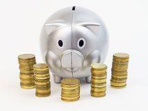 Piggy bank with coins isolated on a white background Stock Image