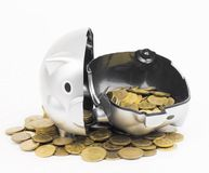 Piggy bank with coins isolated on a white background Stock Photo
