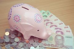 Piggy Bank With Thai Money  Royalty Free Stock Image