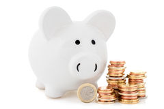 Piggy bank and coins stack Stock Photography