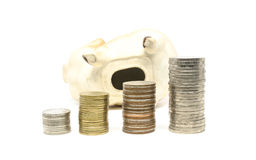 Piggy bank and coins stack Royalty Free Stock Photos