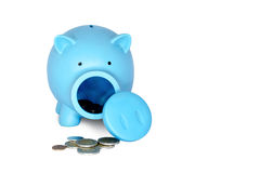 Piggy bank with coins on white isolated background Stock Image