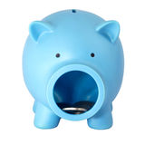 Piggy bank with coins on white isolated background Stock Photography