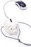 Piggy Bank and computer mouse. Concept of e-commerce, online banking Stock Photo