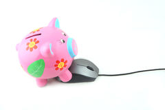 Piggy Bank and Computer Mouse Royalty Free Stock Photo