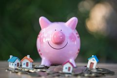 Piggy bank, concept of saving money for house, Savings money for buy house and loan to business investment for real estate concept royalty free stock photos