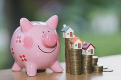 Piggy bank, concept of saving money for house, Savings money for stock photography