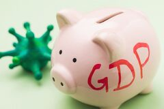 Piggy bank and coronavirus, close-up. Concept on GDP during the pandemic covid-19