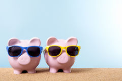 Piggy bank couple vacation saving, holiday money planning, beach, copy space Royalty Free Stock Photos