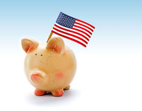 Piggy bank with cracks and national flag of USA Stock Photo