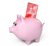 Piggy Bank with Credit Card Royalty Free Stock Image