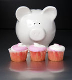 Piggy bank and cupcakes Royalty Free Stock Photo