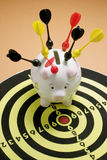 Piggy Bank and Dart Board Royalty Free Stock Photography