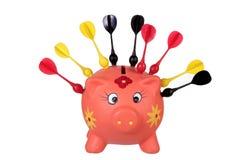 Piggy Bank with Darts Royalty Free Stock Photos