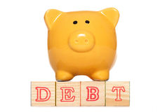 Piggy bank with debt text Royalty Free Stock Image