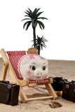 Piggy bank in a deck chair Stock Image