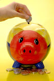Piggy bank deposit Royalty Free Stock Photos