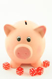 Piggy bank and dices Royalty Free Stock Photo