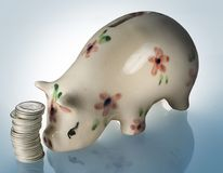 Piggy bank. With dimes on light box Stock Images