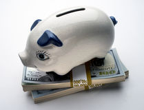 Piggy bank. With dimes on light box Royalty Free Stock Photos