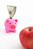 Piggy bank , dollar and apple Royalty Free Stock Photos