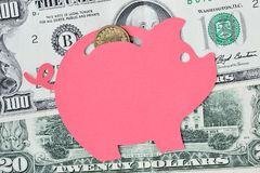 Piggy bank on dollar banknotes and coins - Saving money concept. Piggy bank on dollar banknotes and coins. Saving money concept royalty free stock photography